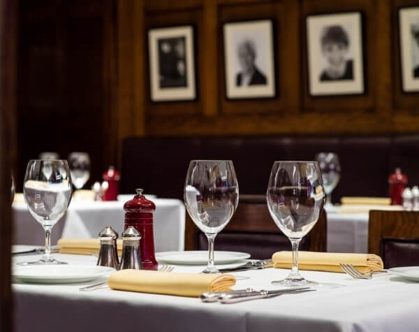 Elegantly laid table inviting romantic dinners and those who enjoy iconic surroundings while being served quality seafood in the West End