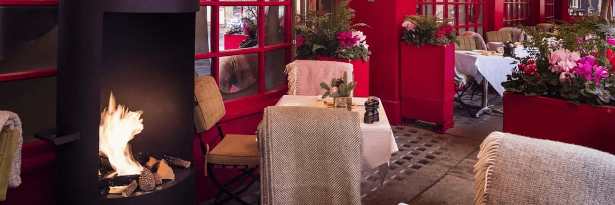 Warm crackling fire with blankets for cozy gatherings on the Terrace to enjoy hot beverages and small bites to share with friends