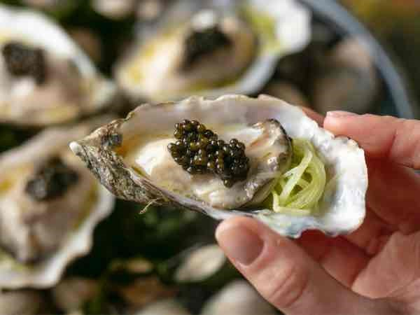 Decadent starter of poached Black Pearl oysters with champagne and caviar